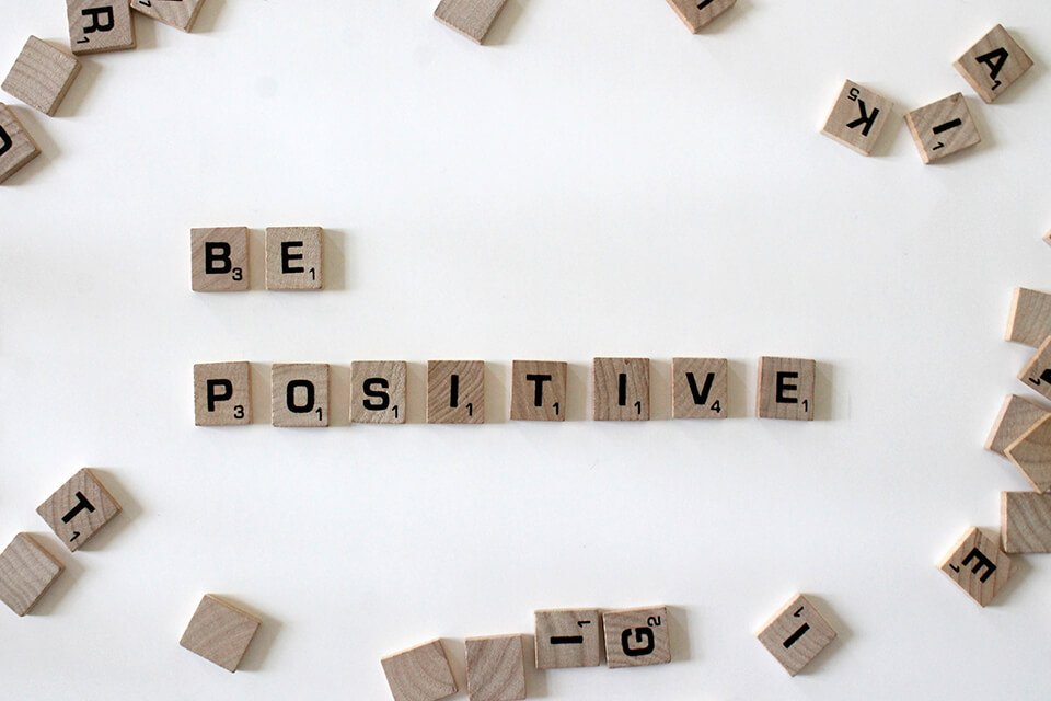 """Letters arranged to say """"be positive"""""""