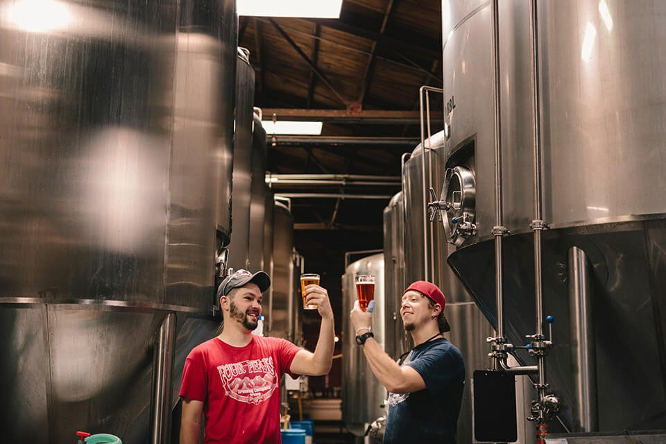 Two men touring a brewery