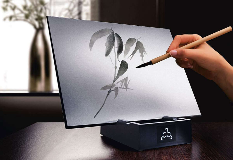 Person using Buddha Board to create a water painting