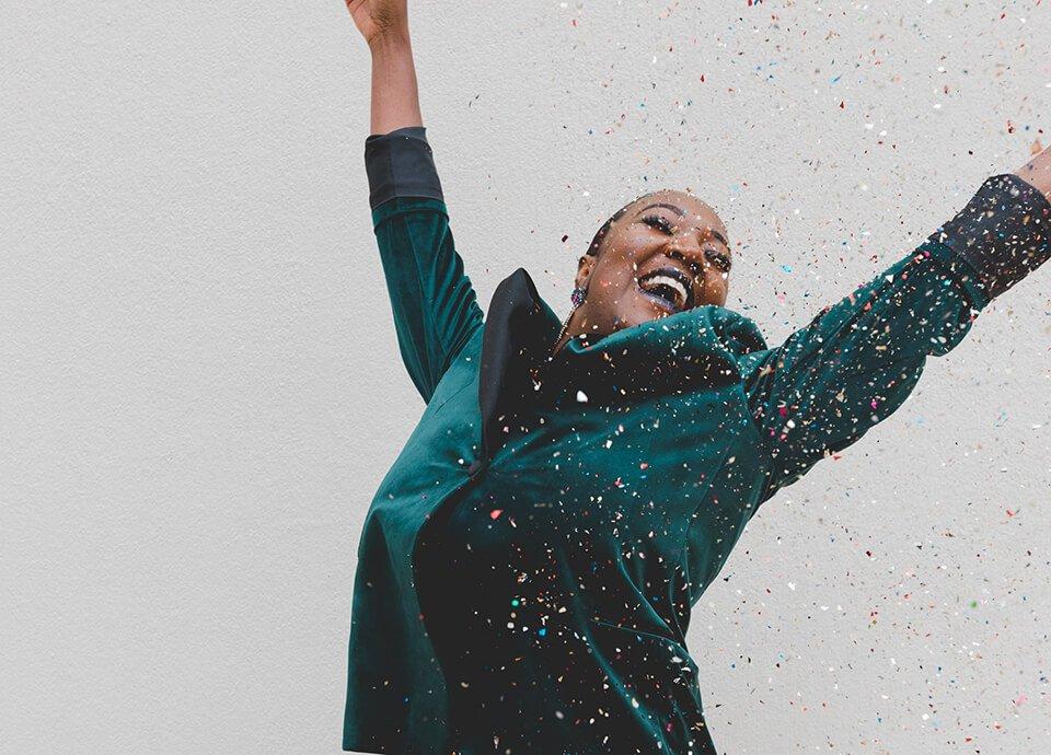 Woman celebrating with confetti