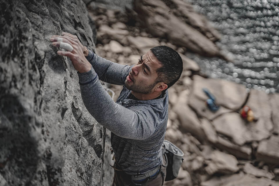 Man overcoming doubt and climbing a rockface