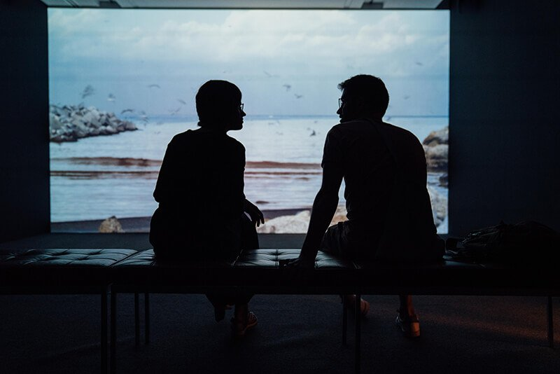 Couple sitting and talking in a museum