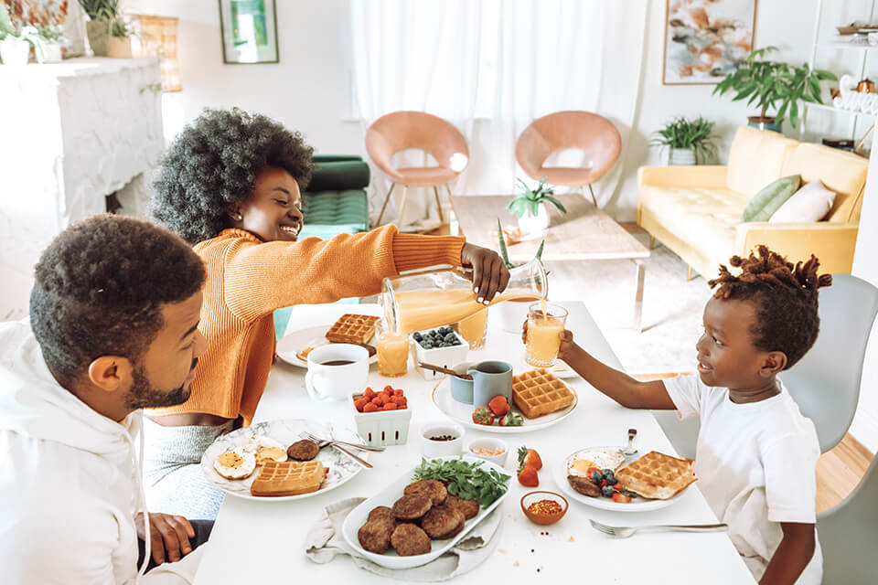 A family eating breakfast together