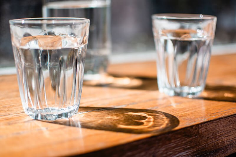 Glasses of water to keep you from falling asleep while meditating lying down