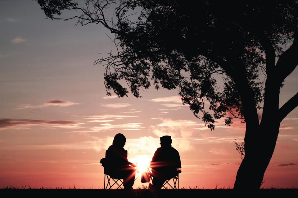 Two friends overlooking a sunset