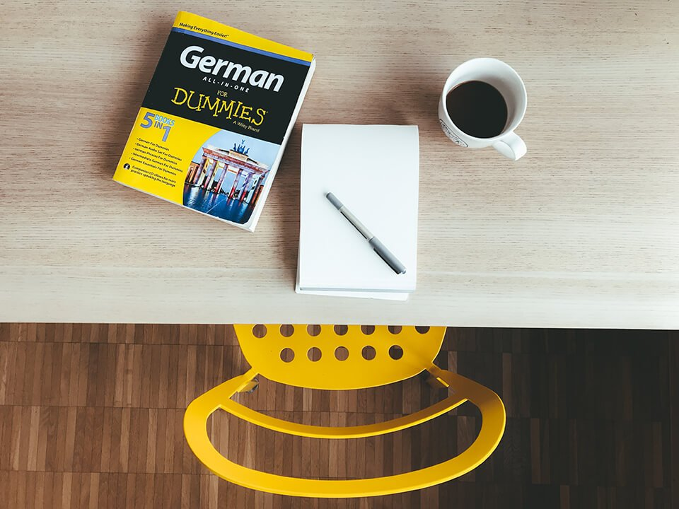 Desk with book on learning to speak German