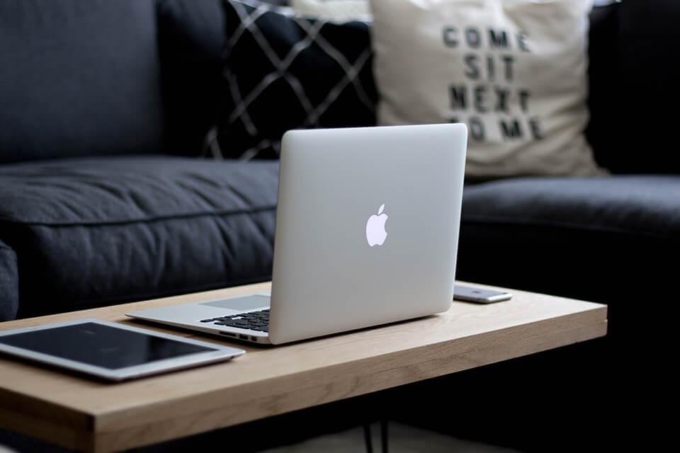 Open Macbook laptop on coffee table