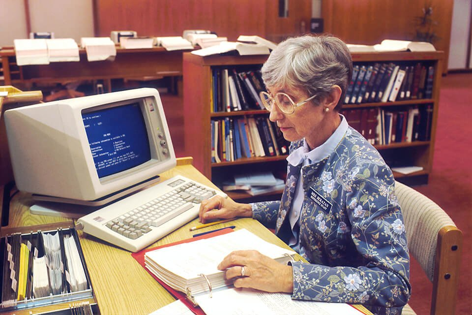 Woman working in a library