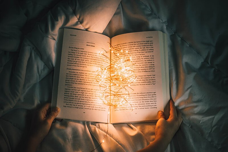 Relaxing at night with a good book to stop overthinking