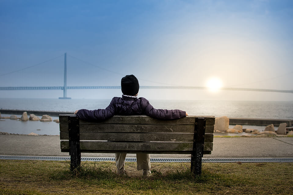 Man sitting on park bench relaxing