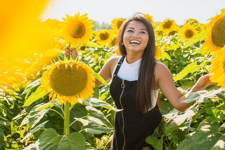Woman smiling in a sunflower field