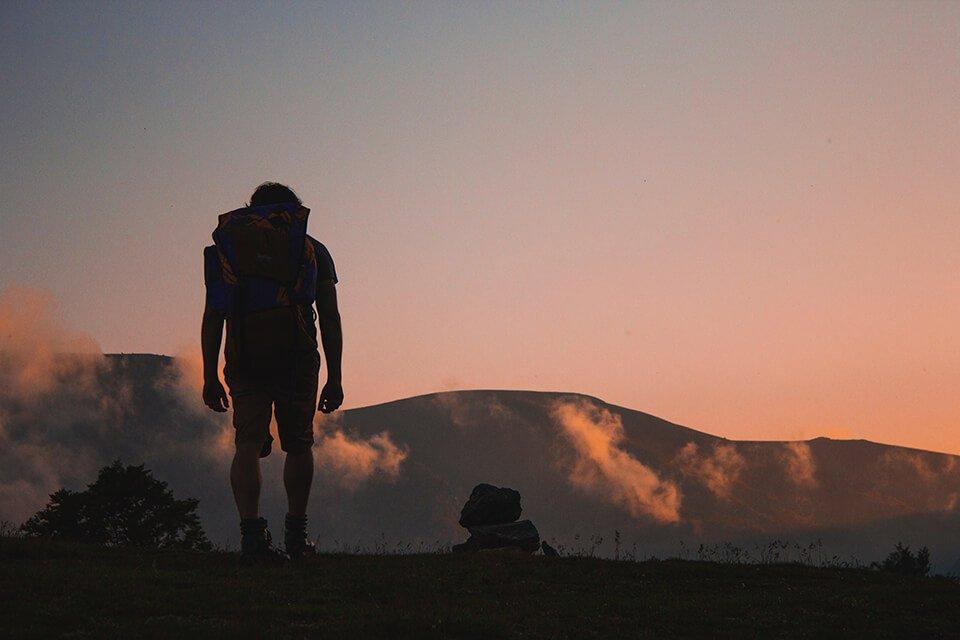 A man hiking during sunset