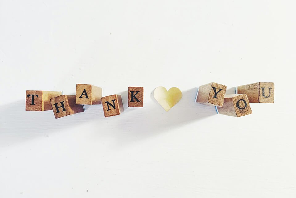 """Letter blocks arranged to spell out """"thank you"""""""