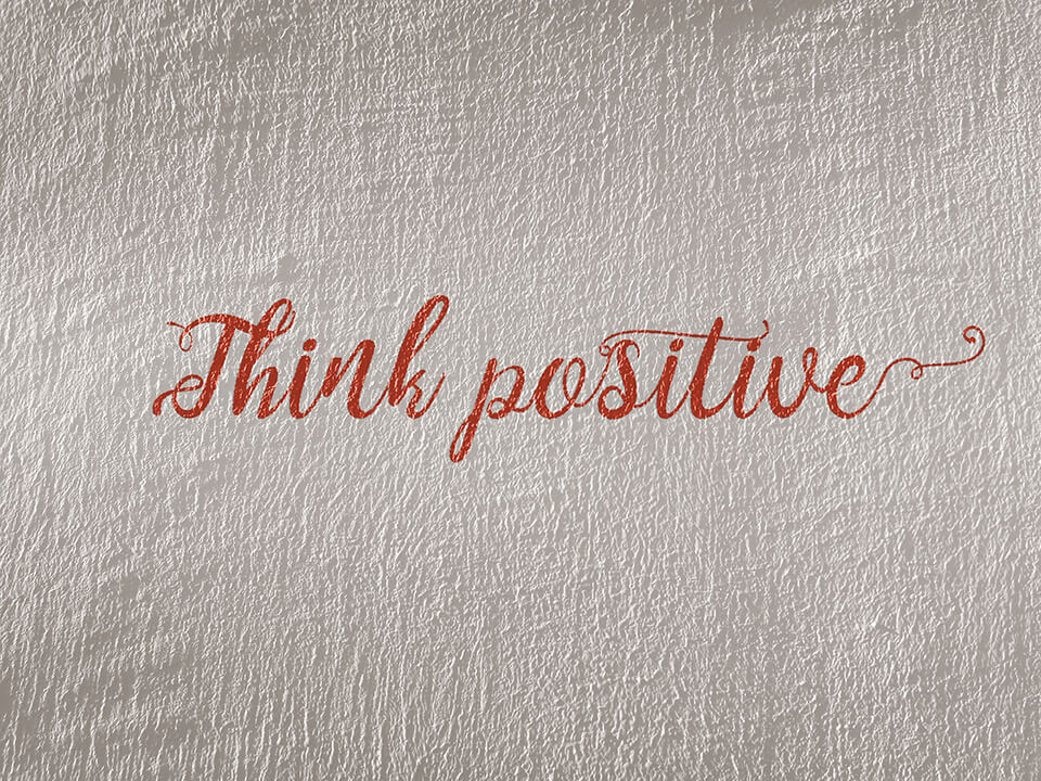 """Writing on wall that says """"think positive"""""""