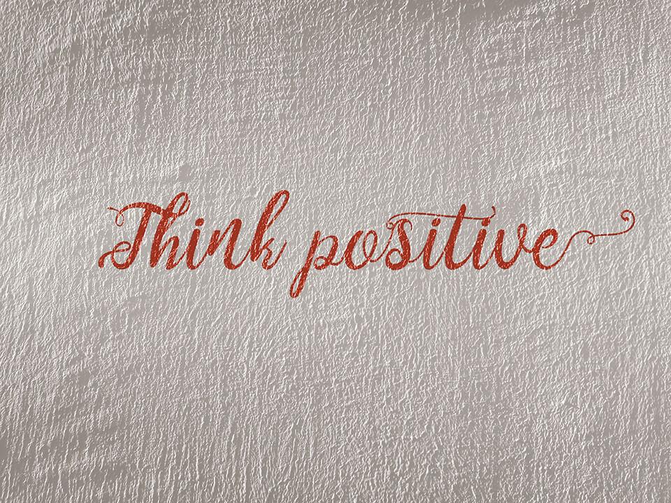 Think positive written on wall
