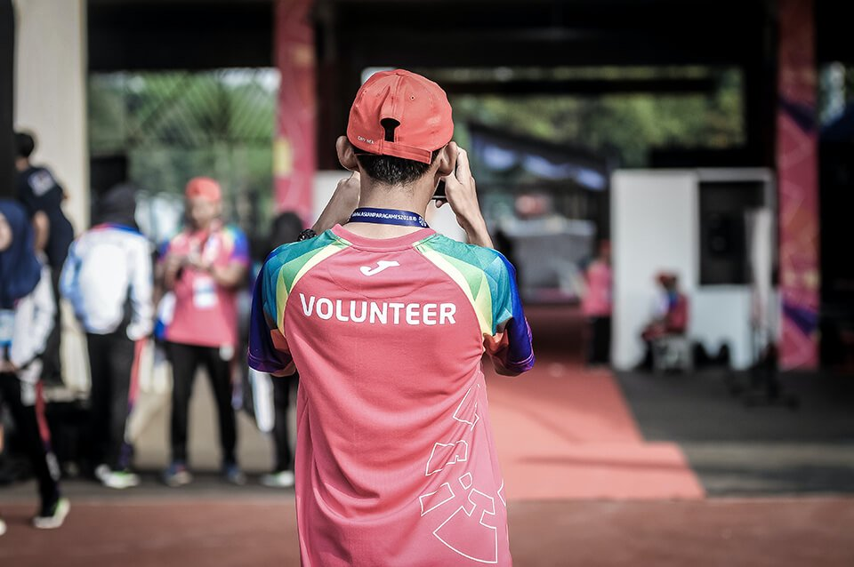 Man working as a volunteer