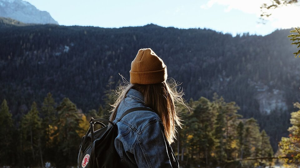 Woman hiking and lost in thought
